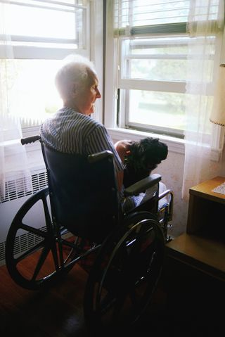 2013-03-18 Old person in wheelchair at window