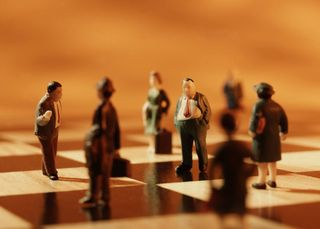 2013-04-12 Business people on chess board