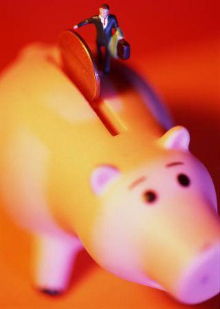 2013-03-22 Business man putting money in piggy bank