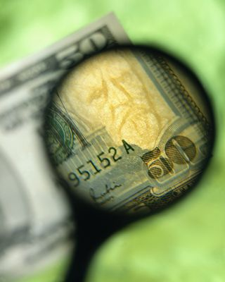 2015-01-16 magnify glass and money